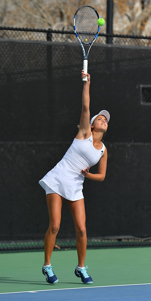 LAS VEGAS, NV - JANUARY 20:  Eli Arnaudova of the New Mexico State Aggies serves during her team's match against McKenna Lloyd of the Weber State Wildcats at the Frank and Vicki Fertitta Tennis Complex in Las Vegas, Nevada. Amaudova won the match 7-5, 6-2.