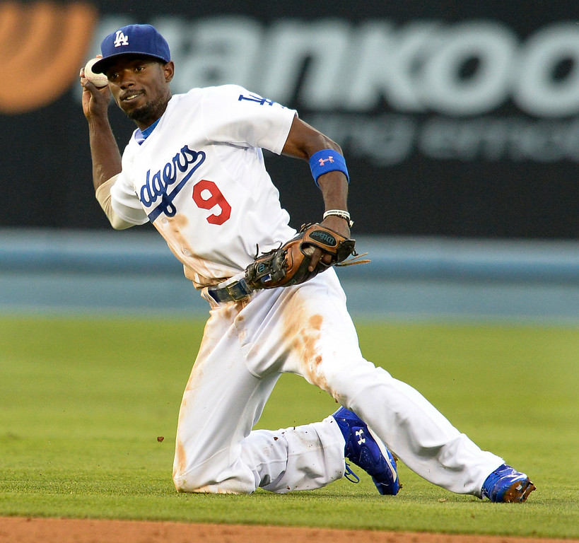 . Dee Gordon traped the ball, but can\'t make the play in the 2nd inning. The Dodgers played host to the Atlanta Braves in a game played at Dodger Stadium in Los Angeles, CA. 7/30/2014(Photo by John McCoy Daily News)