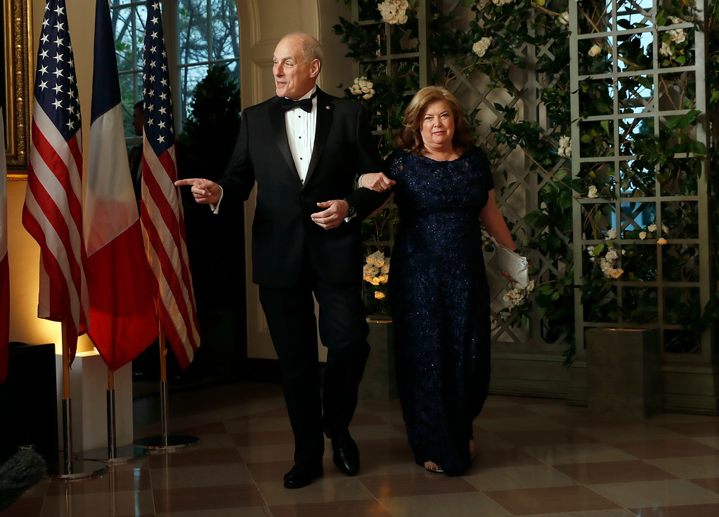 . White House Chief of Staff John Kelly and his wife Karen Kelly arrive for a State Dinner with French President Emmanuel Macron and President Donald Trump at the White House, Tuesday, April 24, 2018, in Washington. (AP Photo/Alex Brandon)