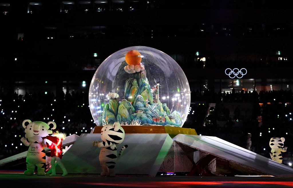 . Olympic mascots stand by a snow globe during the closing ceremony of the 2018 Winter Olympics in Pyeongchang, South Korea, Sunday, Feb. 25, 2018. (AP Photo/Kirsty Wigglesworth)