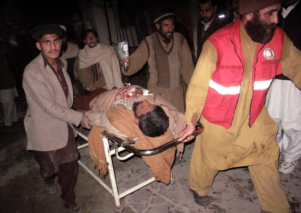 . Rescue personnel wheel an injured man from the scene of a bomb explosion at Maki mosque in Takhtaband, on the outskirts of Mingora, Swat Valley January 10, 2013. About 21 people were killed and more than 60 injured in a bombing where people had gathered to hear a religious leader speak in Mingora, the largest city in the northwestern province of Swat, police and officials at the Saidu Sharif hospital said.   REUTERS/Hazrat Ali Bacha