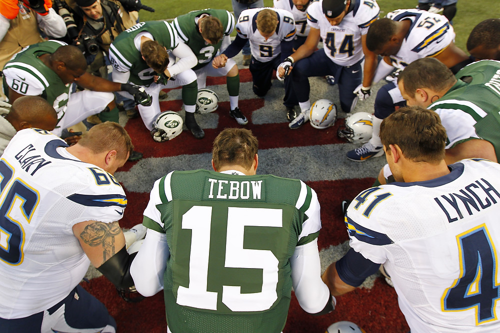 . Quarterback Tim Tebow #15 the New York Jets leads a players prayer after their game against the San Diego Chargers at MetLife Stadium on December 23, 2012 in East Rutherford, New Jersey. The Chargers defeated the Jets 27-17. (Photo by Rich Schultz /Getty Images)
