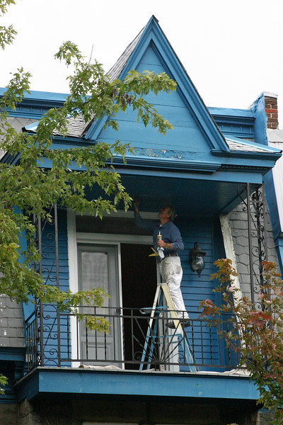 The blue-shirted painter on the beautifully blue balcony caught my eye.