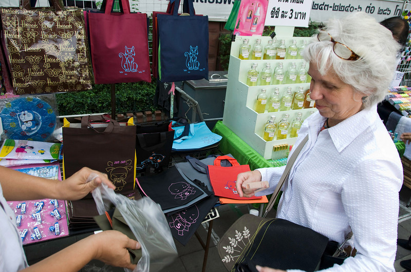 Lyn buys a Hello Kitty tote bag, believing (she later claimed) that it was a licensed product (much like that Harrods bag in the top left of the photo). Although in this photo she's got that look of someone getting away with something.