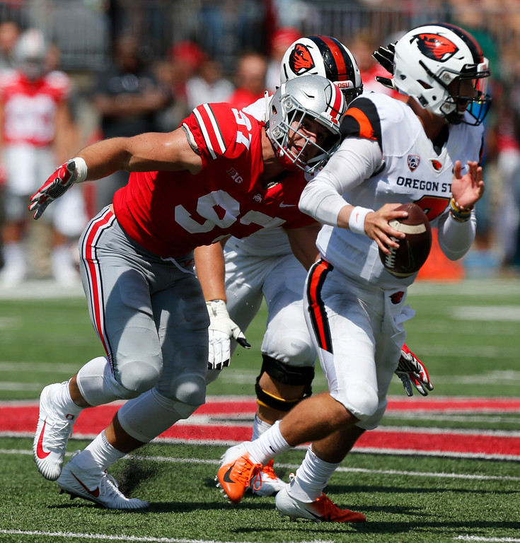 . Ohio State defensive lineman Nick Bosa, left, sacks Oregon State quarterback Conor Blount during the first half of an NCAA college football game Saturday, Sept. 1, 2018, in Columbus, Ohio. (AP Photo/Jay LaPrete)