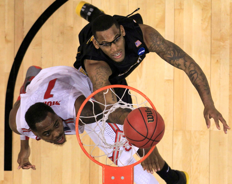. Ohio State Buckeyes forward Deshaun Thomas (1) tries to score on Wichita State Shockers forward Carl Hall (22) in the second half during their West Regional NCAA men\'s basketball game in Los Angeles, California March 30, 2013.  REUTERS/Lucy Nicholson