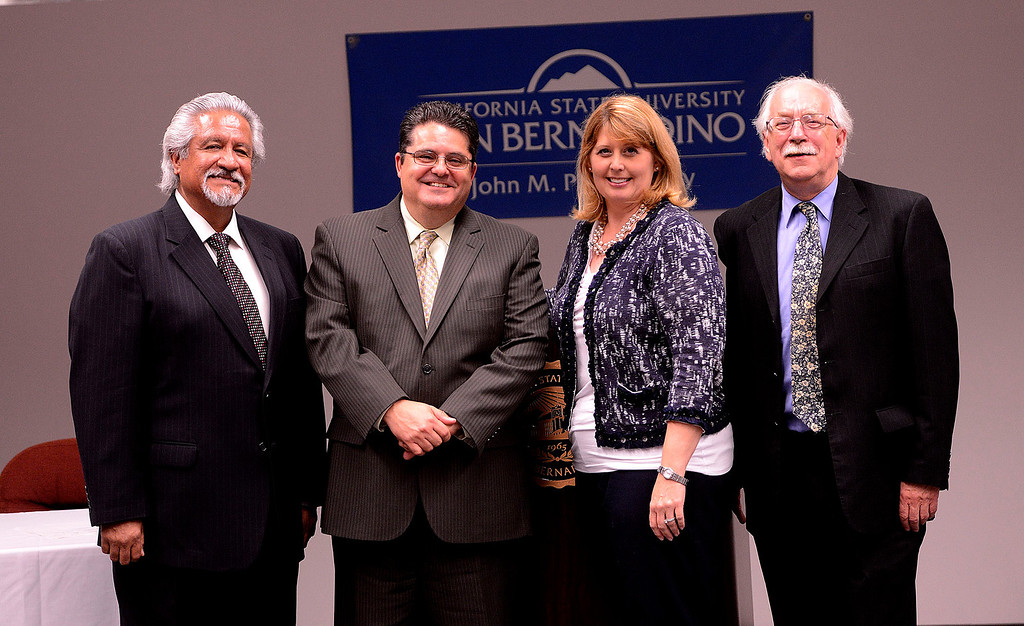 . From left to right:  Dean Cesar Caballero, Los Angeles Newspaper Group Vice President Michael Anastasi, Supervisor Janice Rutherford, and Provost Andrew Bodman stand together after the transferal of The Sun\'s archives to the County at California State University San Bernardino April 8, 2013.   GABRIEL LUIS ACOSTA/STAFF PHOTOGRAPHER.