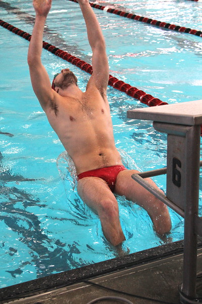 Tate Warden competes in 100 meter backstroke.