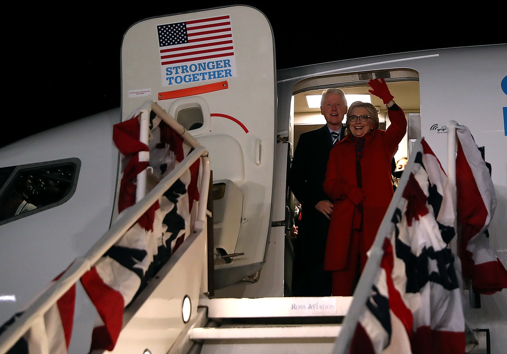 . WHITE PLAINS, NY - NOVEMBER 08:  Democratic presidential nominee former Secretary of State Hillary Clinton (L) and her husband former U.S. President Bill Clinton greet supporters at Westchester County Airport on November 8, 2016 in White Plains, New York. Hillary Clinton wrapped up her campaign by greeting hundreds of supporters at the Westchester County Airport after campaigning in Pennsylvania, Michigan and North Carolina in the lead up to today\'s general election.  (Photo by Justin Sullivan/Getty Images)