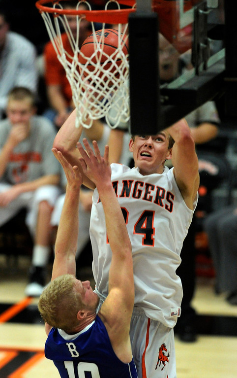 . Rangers forward Justin Smith (24) collided with Eagles\' defender Dan Perse (10) on the way to the hoop. The Lewis-Palmer High School boy\'s basketball team defeated Broomfield 75-53 Friday night, December 7, 2012.  Karl Gehring/The Denver Post