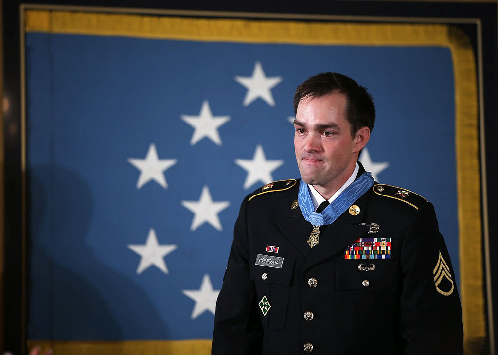 . Clinton Romesha (L), a former active duty Army Staff Sergeant, stands after he was presented with the Medal of Honor for conspicuous gallantry by U.S. President Barack Obama at the White House February 11, 2013 in Washington, DC. (Photo by Alex Wong/Getty Images)
