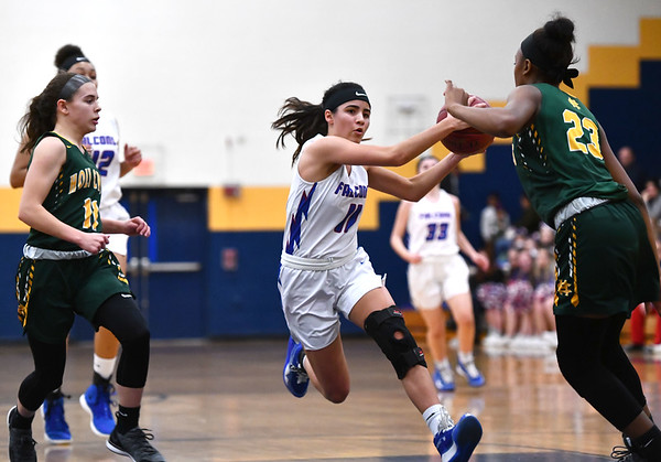 2/26/2020 Mike Orazzi | StaffrSt. Paul Catholic High School's Janessa Gonzalez (11) during Wednesday night's CCC girls basketball tournament with Holy Cross at Kennedy High School in Waterbury. r