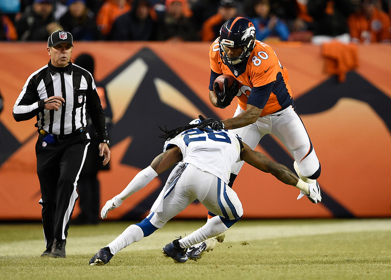 . Julius Thomas (80) of the Denver Broncos picks up a 4-yard gain in the third quarter. The Denver Broncos played the Indianapolis Colts in an AFC divisional playoff game at Sports Authority Field at Mile High in Denver on January 11, 2015. (Photo by Joe Amon/The Denver Post)