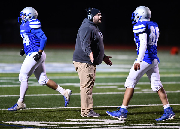11/1/2019 Mike Orazzi | StaffrBristol Eastern Football Coach Anthony Julius against Farmington during Friday night football in Bristol.