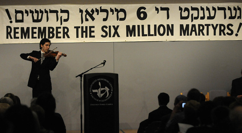 """. Jordan Allen Broder performs \""""Yih\'yu L\'ratzon\"""" or \""""May the Words\"""" on the violin during the beginning of  Yom HaShoah, a Holocaust Day of Remembrance, at the Holocaust Memorial Center in Farmington Hills, Mich., on Sunday, April 7, 2013. (AP Photo/Detroit News, Elizabeth Conley)"""