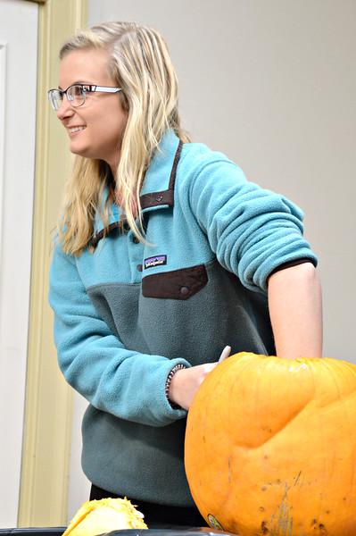 Lacey Warren digs into her pumpkin!