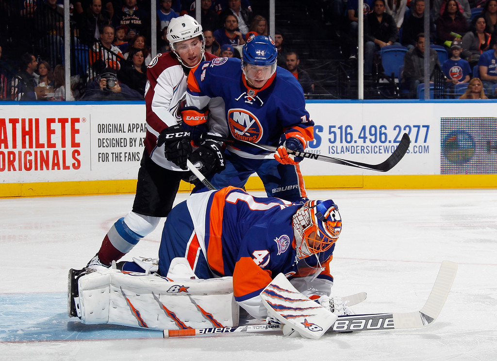 . UNIONDALE, NY - NOVEMBER 11: Jaroslav Halak #41 of the New York Islanders makes the first period save as Matt Duchene #9 of the Colorado Avalanche looks for the rebound at the Nassau Veterans Memorial Coliseum on November 11, 2014 in Uniondale, New York.  The Islanders shutout the Avalanche 6-0. (Photo by Bruce Bennett/Getty Images)