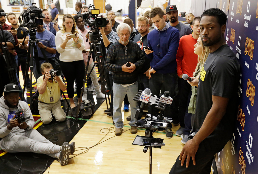 . Cleveland Cavaliers\' Dwyane Wade answers questions during a news conference at the team\'s training facility, Friday, Sept. 29, 2017, in Independence, Ohio. Wade once convinced LeBron James that Miami was the place to be. Seven years later, James lured Wade to Ohio for the chance to win another NBA title, together.(AP Photo/Tony Dejak)
