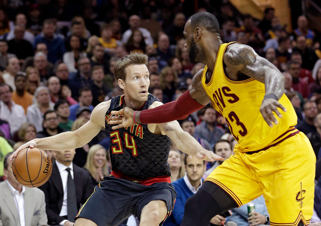 . Atlanta Hawks\' Mike Dunleavy (34) drives against Cleveland Cavaliers\' LeBron James (23) in the first half of an NBA basketball game, Friday, April 7, 2017, in Cleveland. (AP Photo/Tony Dejak)