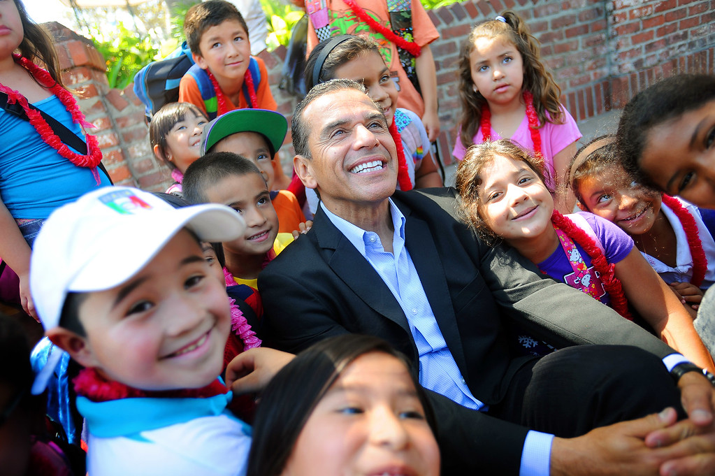 . Mayor Antonio Villaraigosa poses for a photo with youngsters from Hazeltine Elementary School while visiting Olvera Street in Los Angeles, CA June 28, 2013.  Villaraigosa spent the day visiting some of his favorite loactions during his 24-hour goodbye tour.(Andy Holzman/Los Angeles Daily News)