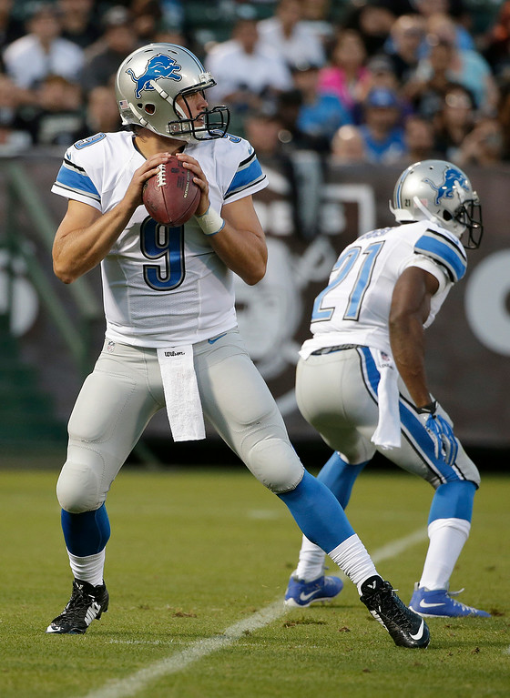 . Detroit Lions quarterback Matthew Stafford (9) passes against the Oakland Raiders during the first half of an NFL preseason football game in Oakland, Calif., Friday, Aug. 15, 2014. (AP Photo/Marcio Jose Sanchez)