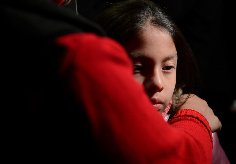 . Cynthia Alvarez (R) is comforted by her mother Lilia as people gather for a prayer vigil at St Rose Church following an elementary school shooting in Newtown, Connecticut, December 14, 2012.  A young gunman slaughtered 20 small children and six teachers on Friday after walking into a school in an idyllic Connecticut town wielding at least two sophisticated firearms. EMMANUEL DUNAND/AFP/Getty Images
