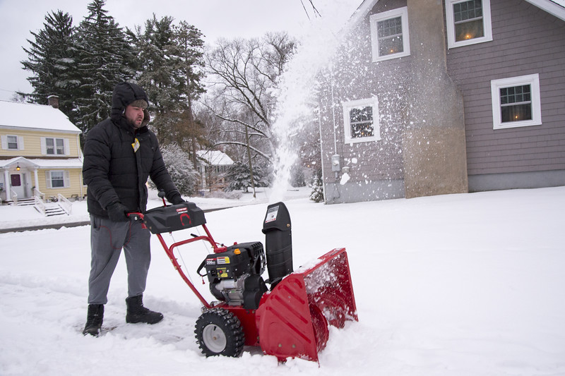 12/02/19  Wesley Bunnell | Staff  Joshua Lynch makes quick work of the sidewalk around his house with a snowblower on Monday afternoon.
