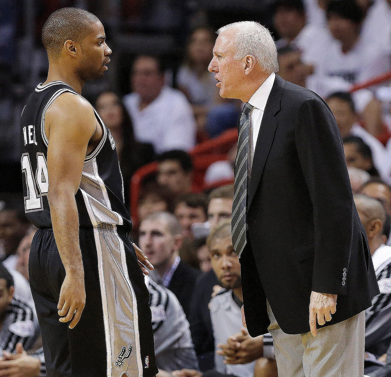 . San Antonio Spurs point guard Gary Neal (14) speaks with San Antonio Spurs head coach Gregg Popovich during the first half of Game 1 of basketball\'s NBA Finals against the Miami Heat, Thursday, June 6, 2013 in Miami. (AP Photo/Lynne Sladky)