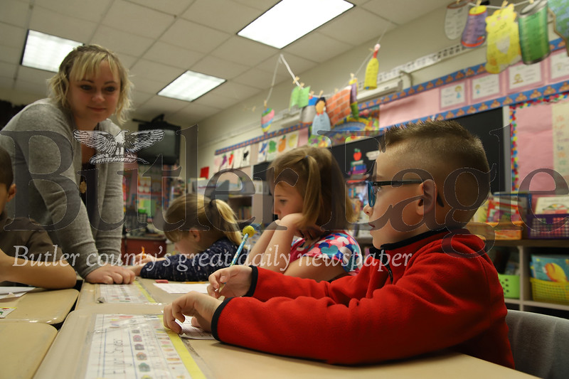 McQuistion Elementary teacher Rene Ruffner  listens to Mother's Day letter ideas from Elijah Snyder (right), Maddalyn MConahy (center) and Emilie Picard.Seb Foltz/Butler Eagle