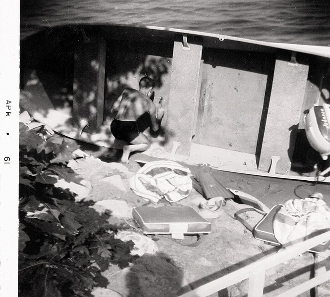 Uncle Butch Patching the Boat 1960.JPG