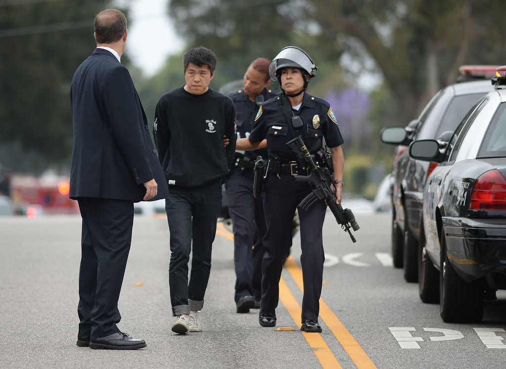 . Shooting at Santa Monica City College Friday. Santa Monica Police walk a suspect in custody from the campus up Pearl Street to be taken into custody. The suspect claimed to the media that he was not the shooter, but that he had found the weapons.