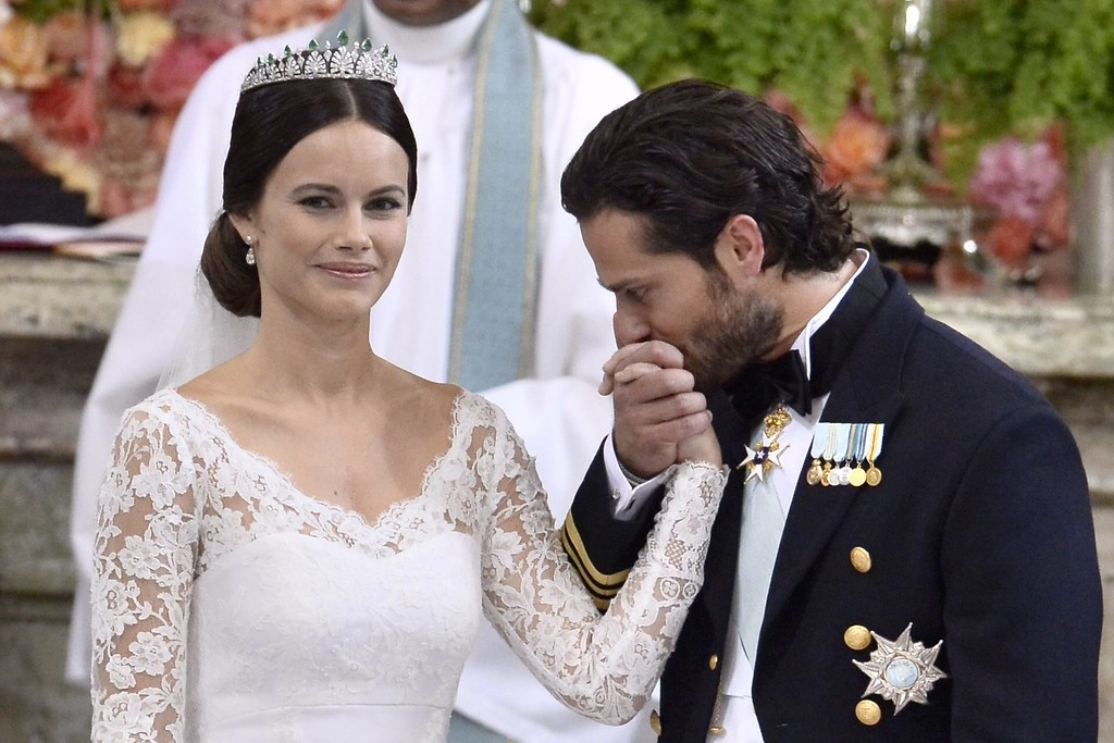 . Sweden\'s Prince Carl Philip (R) kisses Sofia Hellqvist\'s hand during their wedding ceremony at the Royal Chapel in Stockholm Palace on June 13, 2015. AFP PHOTO / TT NEWS AGENCY / Claudio Bresciani/AFP/Getty Images
