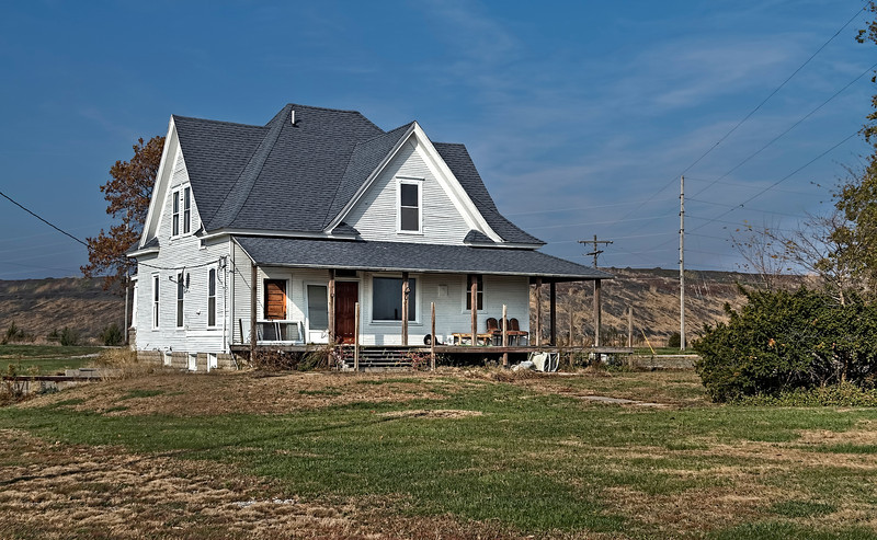This is the main house from the abandoned ranch that had to quit because the water and land became too polluted due to the leaching of the unlined toxic coal slurry impoundment you can see in the background.