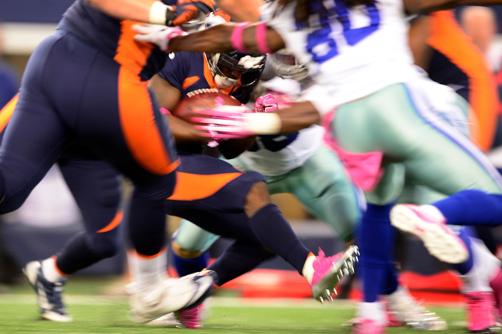. ARLINGTON, TX - OCTOBER 6: Trindon Holliday (11) of the Denver Broncos is tackled on a kickoff against the Dallas Cowboys during the second half of the Broncos\' 51-48 win at AT&T Stadium. The Denver Broncos visit the Dallas Cowboys. (Photo by AAron Ontiveroz/The Denver Post)