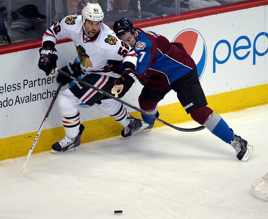 . Colorado Avalanche center John Mitchell (7) runs in to Chicago Blackhawks left wing Brandon Bollig (52) along the boards during the second period November 19, 2013 at Pepsi Center. (Photo by John Leyba/The Denver Post)