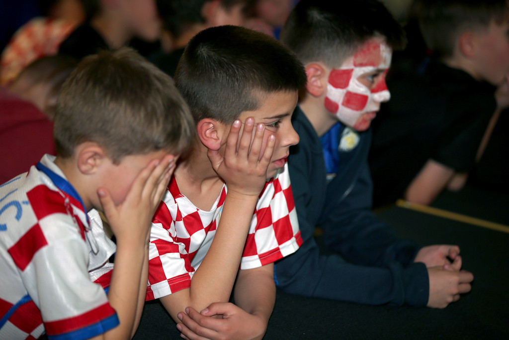 . Young Croatia fans at the King Tom Club in Sydney, Australia, watch the final moments of France and Croatia playing in the soccer World Cup final, Monday, July 16, 2018. (AP Photo/Rick Rycroft)