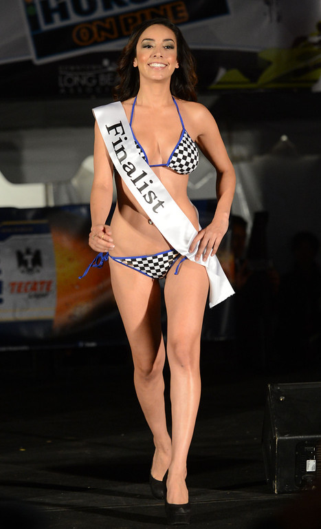 . Long Beach, Calif., -- 04-18-13-  Finalist competes in the 2013 Tecate Light Miss Toyota Grand Prix of Long Beach  pageant Thursday night on Pine Avenue at the Tecate Light Thunder Thursday on Pine.   Stephen Carr/  Los Angeles Newspaper Group