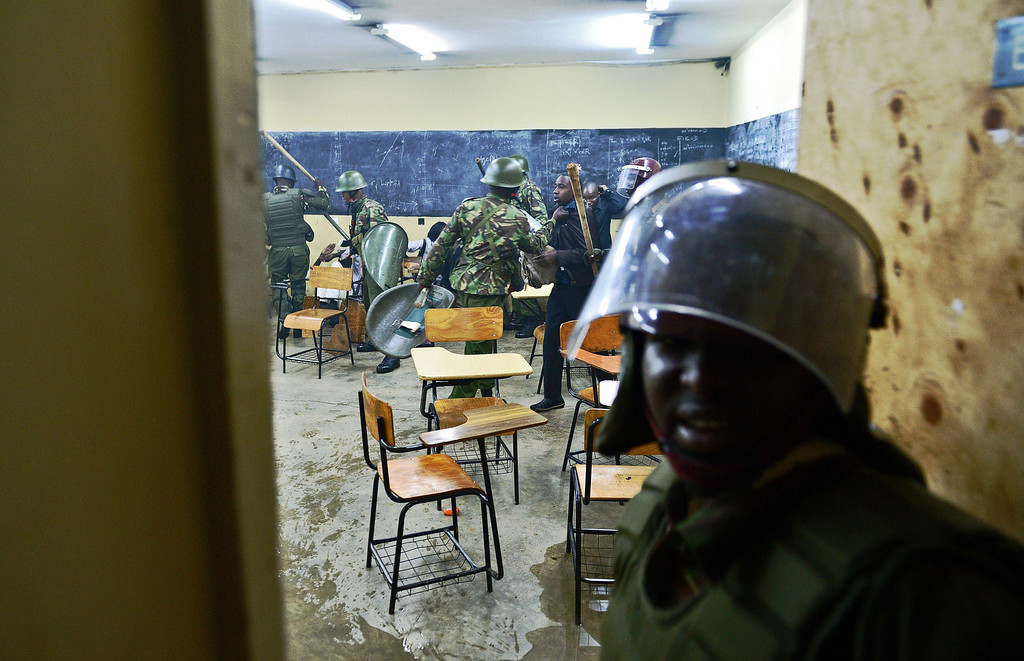 . Kenyan riot police clash with students inside a classroom in Nairobi University on May 20, 2014. The students were protesting against a controversial fee increment which ended in a riot with tear gas fired and riot police forcing their way inside the university to arrest students after rocks were thrown. CARL DE SOUZA/AFP/Getty Images