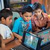 Boys learn computer skills.