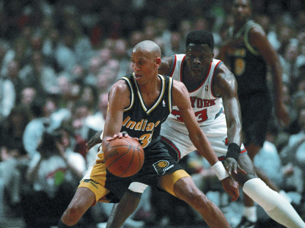 . 11. Reggie Miller, shown at left (Associated Press file)