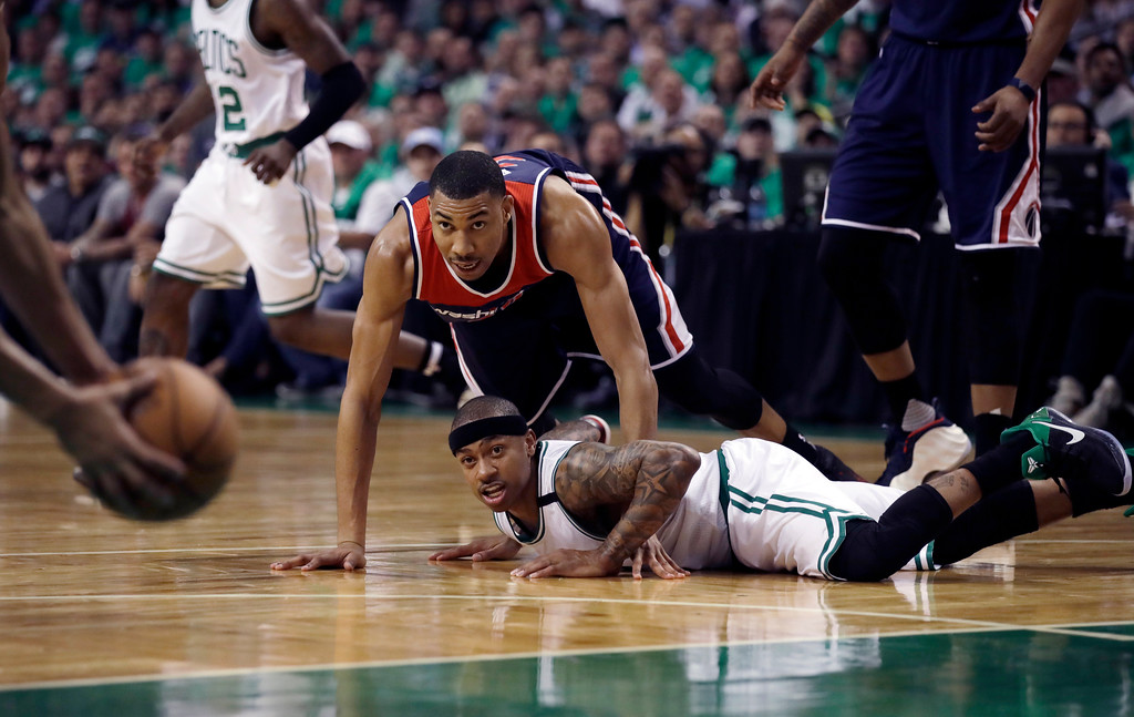 . Washington Wizards forward Otto Porter Jr., top, and Boston Celtics guard Isaiah Thomas keep their eyes on the ball during the second quarter of Game 7 of a second-round NBA basketball playoff series, Monday, May 15, 2017, in Boston. (AP Photo/Charles Krupa)