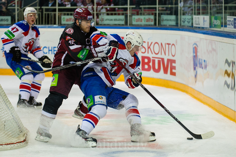 Martins Karsums (15) tries to stop the player of Lev Praha