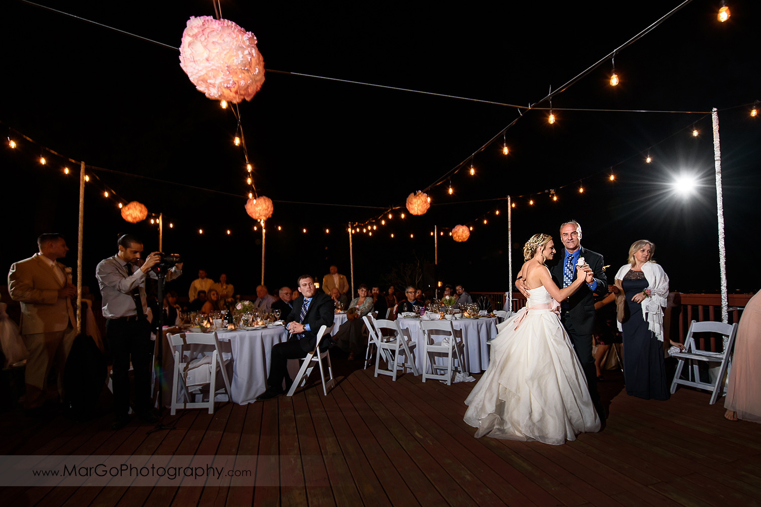 father-dauther dance during backyard wedding reception