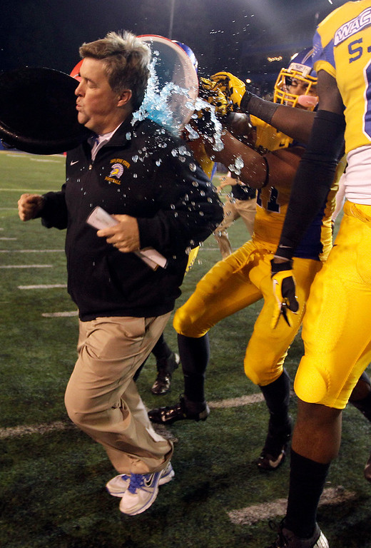 . San Jose State teammates pour water on head coach Mike MacIntyre after their 52-43 win over Louisiana Tech during an NCAA college football game in San Jose, Calif., Saturday, Nov. 24, 2012.(AP Photo/Tony Avelar)