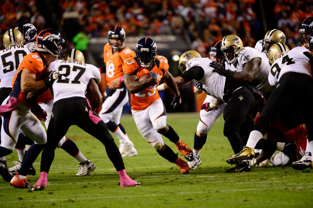 . Willis McGahee runs through a hole in the line in the second quarter as the Denver Broncos took on the New Orleans Saints at Sports Authority Field at Mile High in Denver, Colorado on October 28, 2012. Joe Amon, The Denver Post