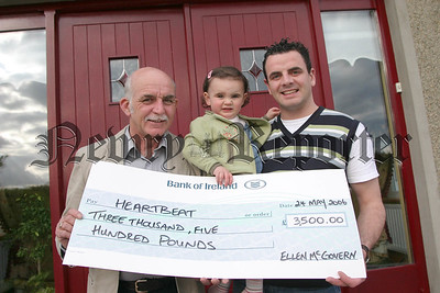 Little Ellen Mc Govern and her dad Gary present a Cheque for £3,500.00 to Irwyn Mc Kibben (chairperson of heartbeat), Ellen and her family would like to thank everyone who contributed through the various fundraising, a supermarket bag pack & donations received at a recent family celebration party. 06W22N65