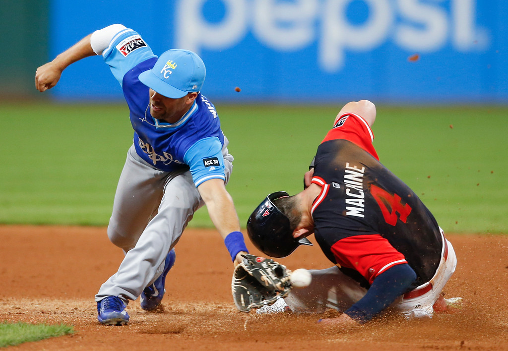 . Cleveland Indians\' Bradley Zimmer (4) steals second base as the ball gets away from Kansas City Royals\' Whit Merrifield during the seventh inning in a baseball game, Saturday, Aug. 26, 2017, in Cleveland. (AP Photo/Ron Schwane)