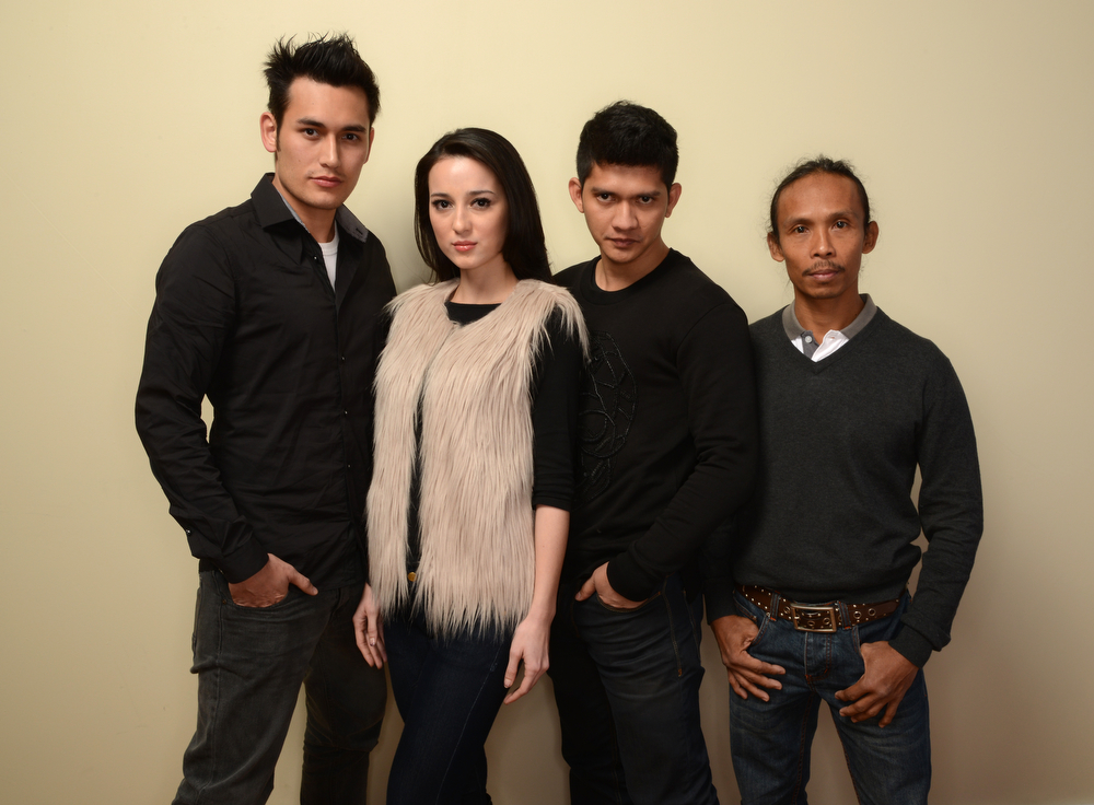 . (L-R) Actors Arifin Putra, Julie Estelle, Iko Uwais, and Yayan Ruhian pose for a portrait during the 2014 Sundance Film Festival at the Getty Images Portrait Studio at the Village At The Lift on January 22, 2014 in Park City, Utah.  (Photo by Larry Busacca/Getty Images)