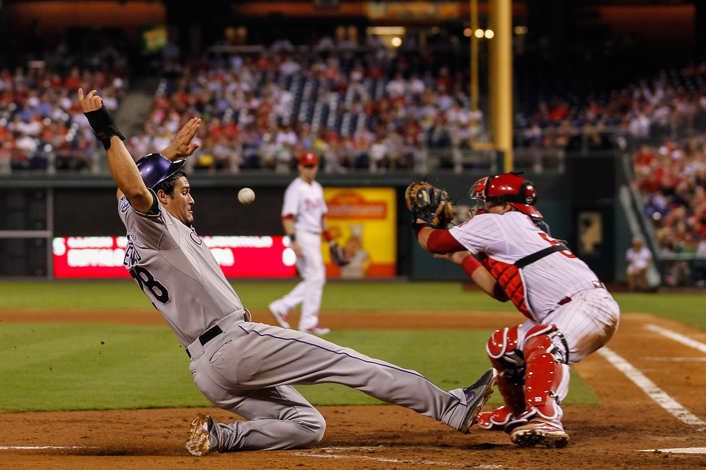 . PHILADELPHIA, PA - AUGUST 22: Nolan Arenado #28 of the Colorado Rockies safely slides home to score a run in the fifth inning of the game against the Philadelphia Phillies at Citizens Bank Park on August 22, 2013 in Philadelphia, Pennsylvania. The Phillies won 5-4. (Photo by Brian Garfinkel/Getty Images)