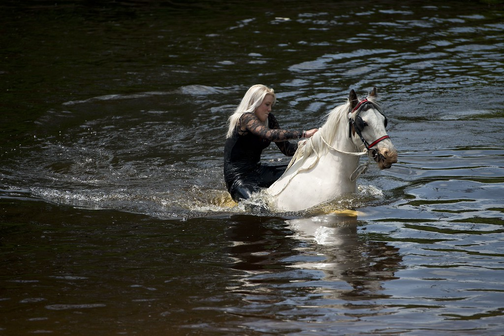 . A woman rides a horse into the River Eden to wash it on the opening day of the annual Appleby Horse Fair, in the town of Appleby-in-Westmorland, North West England on June 4, 2015. The annual event attracts thousands of travelers from across Britain to gather and buy and sell horses. AFP PHOTO / OLI SCARFF/AFP/Getty Images